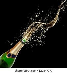 Celebration theme with splashing champagne, isolated on black background