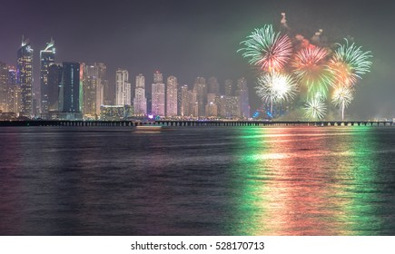 Celebration of UAE National Day with fireworks over the Marina JBR district. Dubai, United Arab Emirates - 02/DEC/2016