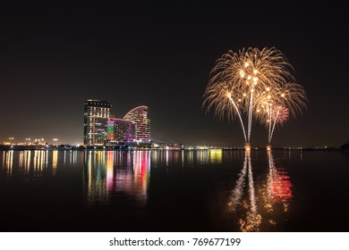 Celebration of UAE National Day with fireworks over the Festival City district. Dubai, United Arab Emirates.