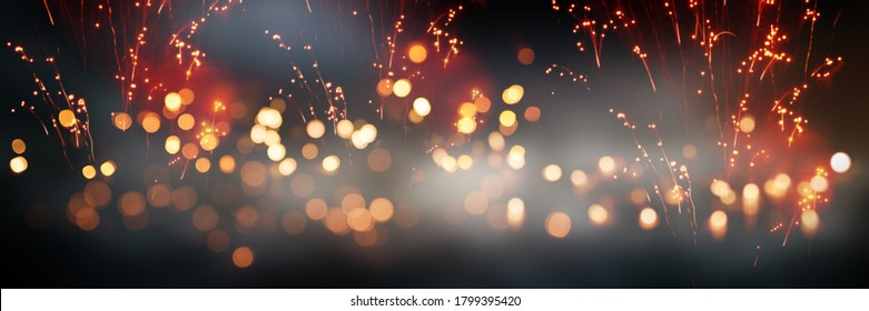 Celebrations with fireworks and bokeh. Horizontal background with blur effects and sparks for silvester and wedding. Special occasion concept with space for text.