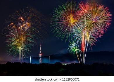 Celebrations light up the sky around the Saturn V rocket in Huntsville, AL