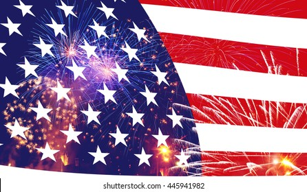 Celebratory fireworks and crowd of people on the background of the US flag. Independence day