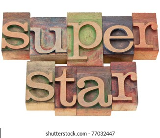 celebrity concept - superstar word in vintage wood letterpress printing blocks, isolated on white