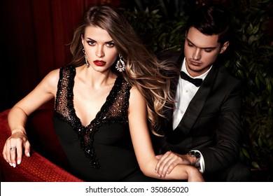 Celebrity couple. Fashionable pair of elegant people.