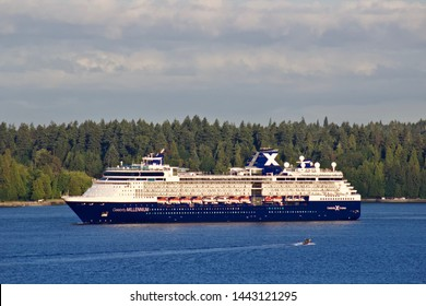 Celebrity Millennium sails past Stanley park into Vancouver Harbour.  Vancouver, BC/Canada/ June 21st 2019