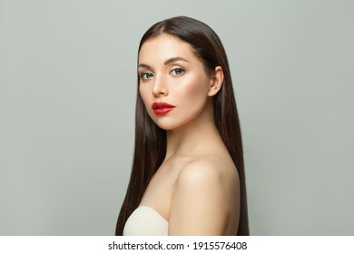 Celebrity woman brunette with clear skin and long healthy straight hair on white background