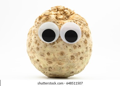 celeriac with googly eyes on white background - celeriac face