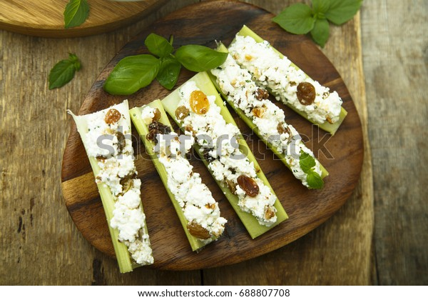 Celery appetizer with cream cheese and dried fruits