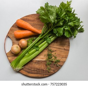 Celery, carrot, onion and thyme stew ingredients on  chopping board