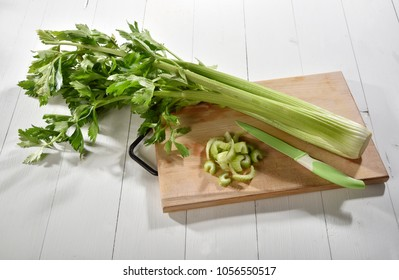 Celery on the cutting board with some cut pieces