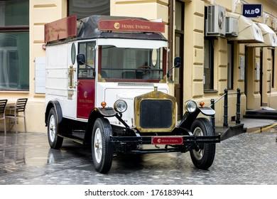 CELJE, SLOVENIA - APRIL 21, 2014: The white vintage van as an advertisement for Hotel Evropa in Celje, Slovenia