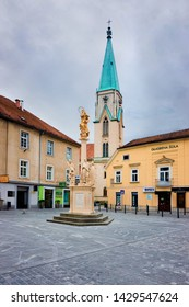 Celje, Slovenia - March 27, 2019: Cityscape with Cathedral at main Stane Street in Celje old town in Slovenia. Architecture in Slovenija. Travel