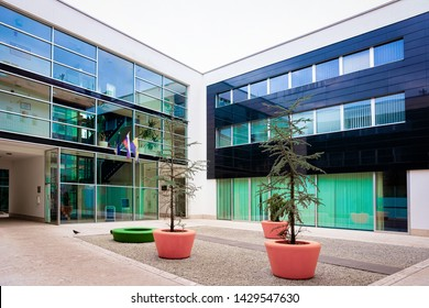 Celje, Slovenia - March 27, 2019: Modern office building in the center of Celje old town in Slovenia. Architecture in Slovenija.