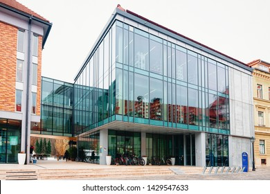 Celje, Slovenia - March 27, 2019: Modern glass library building at the center of Celje old town in Slovenia. Architecture in Slovenija.