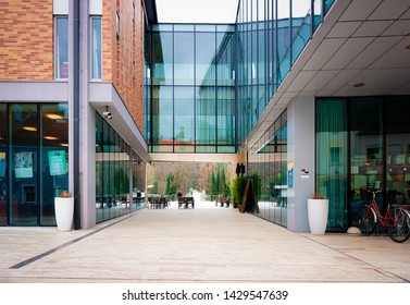 Celje, Slovenia - March 27, 2019: Modern glass library building in the center of Celje old town in Slovenia. Architecture in Slovenija.