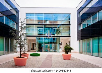 Celje, Slovenia - March 27, 2019: Modern office building at the center of Celje old town in Slovenia. Architecture in Slovenija.