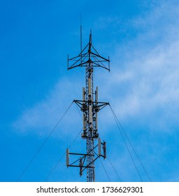 Cell Phone Antenna Tower in front of blue sky