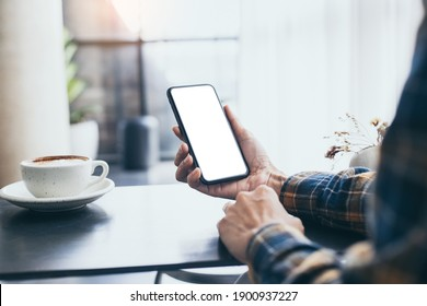 cell phone blank white screen mockup.woman hand holding texting using mobile on desk at office.background empty space for advertise.work people contact marketing business,technology