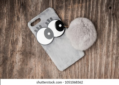 Cell phone case with big eyes and fluffy fur pendant