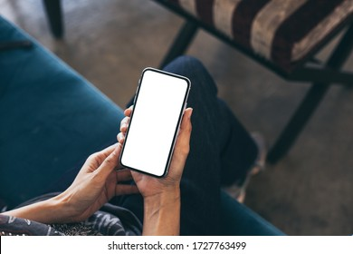 cell phone Mockup image blank white screen.woman hand holding texting using mobile on desk at coffee shop.background empty space for advertise.work people contact marketing business,technology