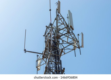 Cell phone tower communication. 3G, 4G and 5G broadcast mobile antennas with daylight and a blue sky in the background