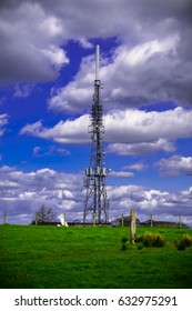 Cell Phone Tower, Communication Tower with Blue Sky And Clouds, England UK