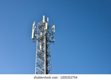 Cell Phone Tower or Mobile cell site with clear blue sky background, Wireless Communications and Networks technology