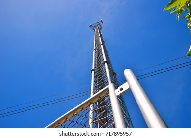 Cell Phone Tower or Mobile cell site with blue sky background, Wireless Communications and Networks technology