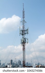 cell site on rooftop buildings city cloud sky background clearing day