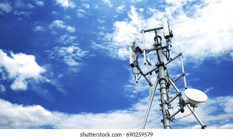 Cell site Post on the roof top. telecommunication technology pillar in the clear blue sky with flare and filter added.