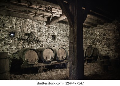 """Cellar with traditional cider barrels, at the """"Caserío"""", typical wooden house of the Basque Country"""