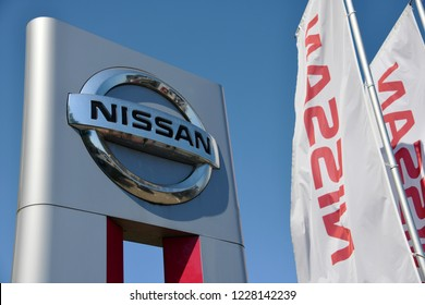 Celle, Lower Saxony / Germany - May 22, 2018: official dealership sign of Nissan against blue sky in Celle, Germany - Nissan is a Japanese multinational automaker