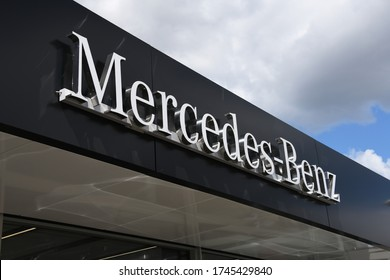 Celle, Lower Saxony / Germany - May 5, 2020: The logo of automobile manufacturer Mercedes-Benz in Celle, Germany - Mercedes is a global automobile marque, division of Daimler AG