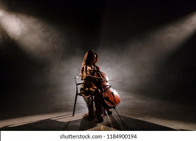 The cellist performs on stage.