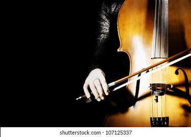 Cello classical music instrument of orchestra. Cellist on black background