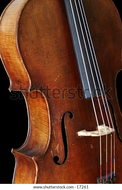 A cello isolated on a black background.