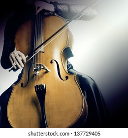 Cello musical instrument cellist musician playing. Woman with cello