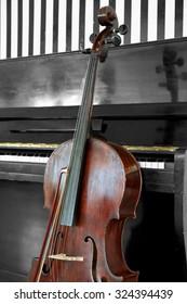 Cello near piano, closeup