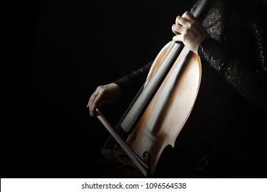 Cello player. Cellist hands playing cello  orchestra music instrument closeup