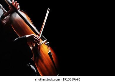 Cello player. Cellist hands playing cello orchestra instrument closeup. Violoncello