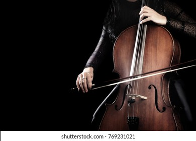 Cello player. Cellist playing cello hands with bow Orchestra music instrument close up