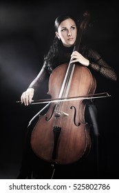Cello player cellist playing violoncello. Woman violoncellist with music instrument
