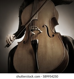 Cello player Cellist playing violoncello musical instrument of orchestra. Close up cello with bow in hands cellist