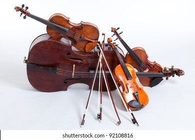 Cello and three violins, all vintage instruments.