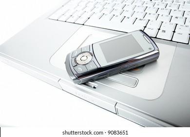Cellphone over a laptop computer kayboard