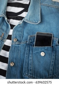 Cellphone in a pocket of jeans jacket