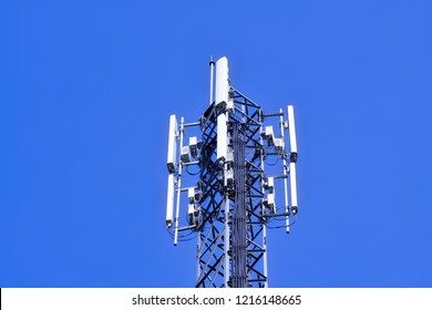 Cellular Base Station or Base Transceiver Station. Telecommunication tower. Wireless Communication Antenna Transmitter. 3G, 4G and 5G Cell Site with blue sky.
