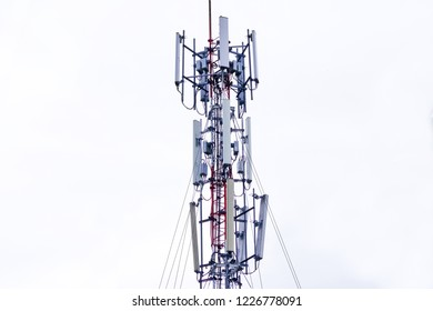 Cellular Base Station or Base Transceiver Station. Telecommunication tower. Wireless Communication Antenna Transmitter. 3G, 4G and 5G Cell Site with on white background.
