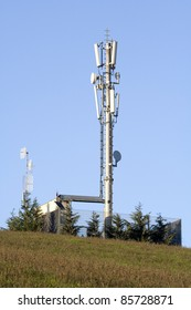 Cellular network: mobile telephony radio tower (fixed-location transceiver known as a cell site or base station).