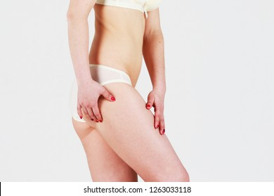 Cellulite removal on skin girl. Plastic surgery on body woman.